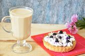 Irish Coffee With Tart Or Cake With Cream And Blueberries poster