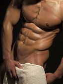 Sport And Workout. Man With Muscular Wet Body And Torso In Bath Towel. Athletic Bodybuilder Man On B poster