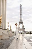 Caucasian Woman Walking On Trocadero Square Near Gilded Statues And Eiffel Tower In Paris. Concept O poster