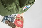 Some Cuban Pesos With Heroes Icon Of Guevara And Cienfuegos And Military Cap poster