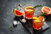 Grapefruit And Rosemary Gin Cocktail, Refreshing Drink With Ice. poster