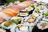 Various Kinds Of Sushi Served On Table. Sushi Set Sashimi And Sushi Rolls. poster