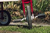 Front Wheel With Pedals. Part Of The Childrens Three-wheeled Bicycle Of The Ussr 80S poster