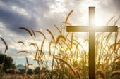 Silhouette Cross In Blue Sky Background Symbol For Easter Sunday, Christian And Funeral. poster