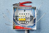 Installation Of A Household Electrical Panel Or Fusebox With Automatic Fuses. A Repairman Left A Wor poster