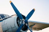 Pilot Cabin Propeller And Wing Of An Old Vintage Airplane Isolated On Blue Sky Background poster