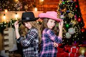 Christmas Party Concept. Girls Sisters Carnival Hats Costumes New Year Party. Kids Friends Celebrate poster