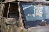 Bullet Hole On A Car Windshield. Car Window After A Raid Has A Bullet Hole. Broken Glass. Bullet Hol poster