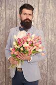 Man Well Groomed Wear Tuxedo Bow Tie Hold Flowers Bouquet. Invite Her Dating. Romantic Man With Flow poster