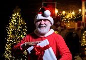 Santa Man With Christmas Gift Box. Merry Christmas And Happy New Year. Santa Claus Holds Present. Ne poster