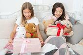 Birthday Surprise. Surprised Kids. Birthday Girls. Happy Children Receive Birthday Gifts In Bed. Enj poster