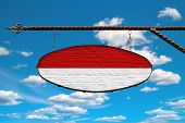 Monaco Flag On A Signboard. Oval Signboard Colors Monaco Flag Hanging On A Metal Forged Structure. T poster