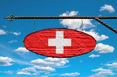Switzerland Flag On Signboard. Oval Signboard Colors Flag Switzerland Hangs On A Metal Forged Struct poster