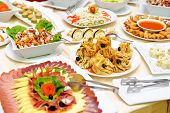 picture of buffet lunch  - Table full of colorful and tasty food - JPG