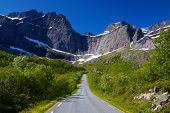 stock photo of lofoten  - Scenic road on Lofoten islands in Norway on sunny summer day - JPG