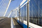 foto of ijs  - Tram on the Enneus Heerma bridge in Amsterdam - JPG