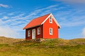 picture of red siding  - Bright Red Siding House in Iceland - JPG