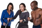 foto of imbecile  - Young caucasian woman exercising in imbecile while trainer encourage her and friend measure time - JPG