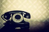 stock photo of green wall  - vintage old telephone - JPG