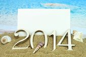New year 2014 card on the beach