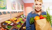 stock photo of department store  - woman shopping for fruits and vegetables in produce department of a grocery store - JPG