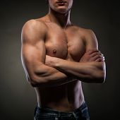 stock photo of nake  - Muscular naked man on black - JPG