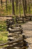stock photo of split rail fence  - A natural trail in a forest park made of wood chips and a split rail fence - JPG