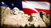 image of rock carving  - Composite image of Mount Rushmore and American Flag.