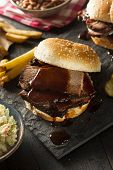 stock photo of brisket  - Smoked Barbecue Brisket Sandwich with Coleslaw and Bake Beans - JPG