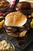 foto of brisket  - Smoked Barbecue Brisket Sandwich with Coleslaw and Bake Beans