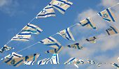 image of israel people  - Israel flag in white and blue showing the Star of David hanging proudly for Israel - JPG