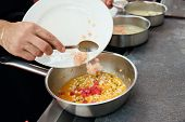 stock photo of sauteed  - Chef is cooking seafood sautee at professional kitchen - JPG
