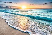 stock photo of sunrise  - Beautiful sunrise over beach in Cancun, Mexico