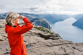 stock photo of flat-foot  - Woman hiker on Pulpit Rock  - JPG