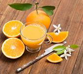 pic of orange blossom  - Fresh orange juice orange with leaves and blossom on the wooden table - JPG