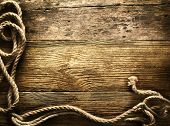 stock photo of roping  - Ship ropes on a wooden background - JPG