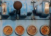 stock photo of levers  - Old rusty pressure valves and levers on an industrial machine - JPG