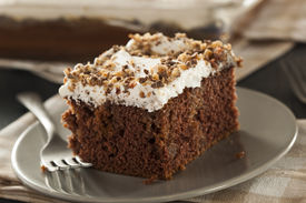 stock photo of toffee  - Homemade Toffee and Chocolate Cake with Vanilla Frosting - JPG