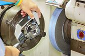 picture of micrometer  - opertor measuring cnc grinding part by micrometer  - JPG
