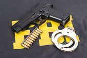 picture of ammo  - fbi concept with gun ammo and handcuffs - JPG