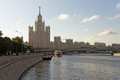 stock photo of highrises  - Moscow city center highrise tower on the sunrise and yacht sailing in the river - JPG