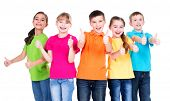 stock photo of stand up  - Group of happy kids with thumb up sign in colorful t - JPG