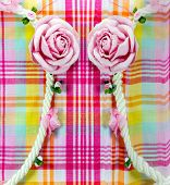 stock photo of loincloth  - background pattern of Fabric line with artificial flowers rose - JPG