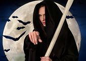 foto of scythe  - Witch death with  scythe on  background of moon and bats - JPG