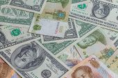 picture of yuan  - A lot of yuans and dollars banknotes wallpaper - JPG