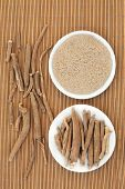 stock photo of ashwagandha  - Ginseng ashwagandha herb root and korean powder over bamboo background - JPG