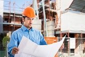 stock photo of power-shovel  - Portrait of an architect at work in a construction site - JPG