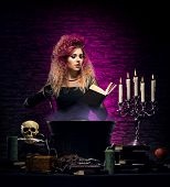 picture of dungeon  - Young and beautiful witch in a dungeon - JPG
