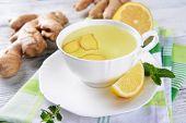 foto of rhizomes  - Ginger tea with lemon on table close - JPG