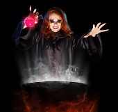 stock photo of witches cauldron  - Young witch with potion and cauldron isolated - JPG